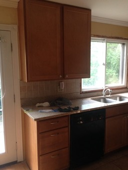 Complete set of kitchen cabinets including granite countertop